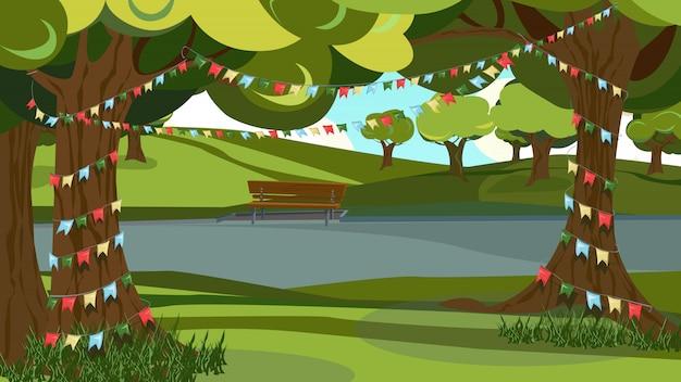 Зеленое дерево украшено, гирлянда овсянка флаг в парке