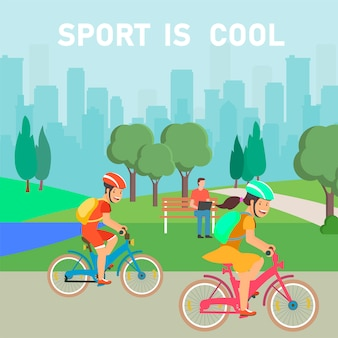 都市公園における女の子と男の子のスポーツ愛好家のサイクリング