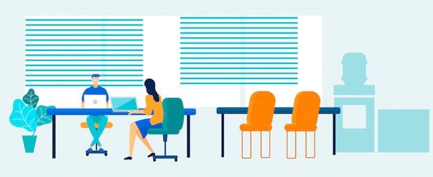 コワーキングスペースでラップトップに取り組んでいるオフィスの人々