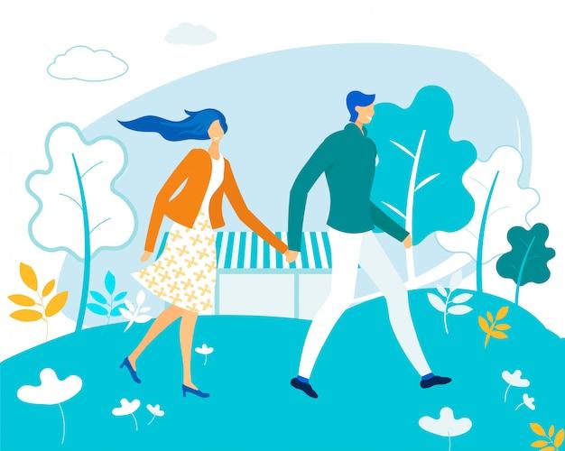 公園を歩いて手を取り合って幸せな愛情のあるカップル