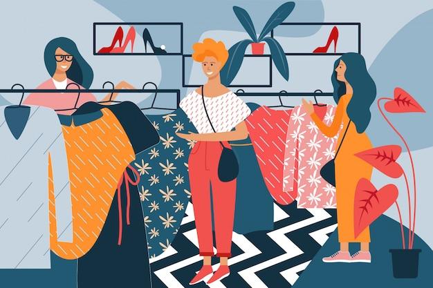 衣料品店で手にドレスを持つ女性。