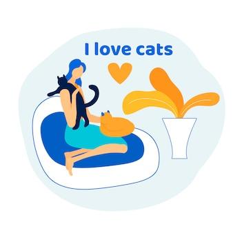 女性は猫を持つ動物の世話をする