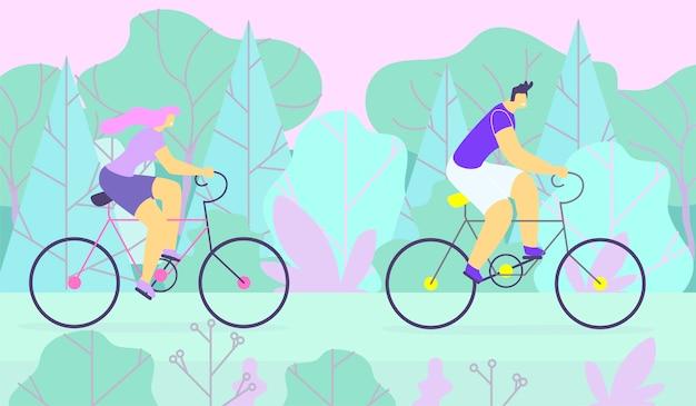 スポーティな男と女のカップルが森でサイクリング