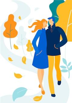 暖かい服を着て歩いて、愛の幸せなカップル