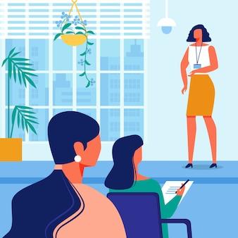 青いインテリアとホールでの女性のビジネストレーニング
