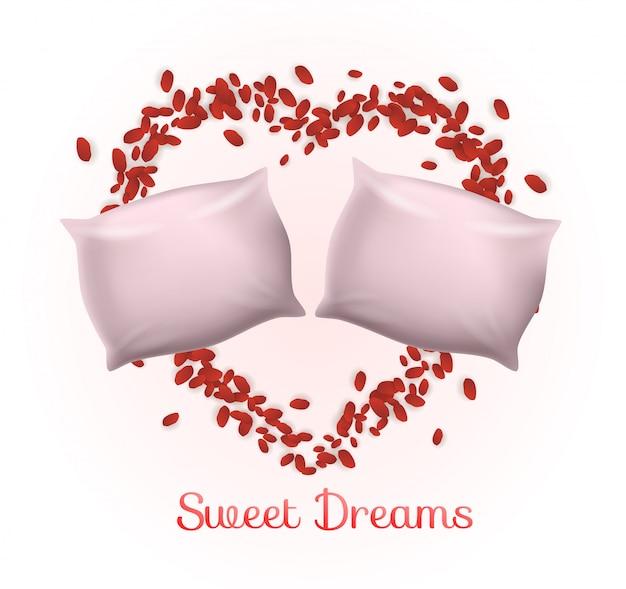 バラの花びらのハートフレームの中の枕のカップル