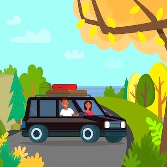 男と女のトップ山に黒い車のそばに立つ