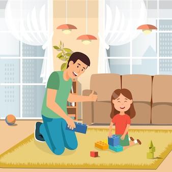 Отец играет в игрушки кирпичи с дочерью дома