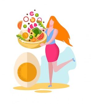 若い女性は新鮮なサラダと巨大なプレートを保持します。