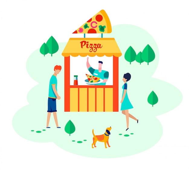 ピザの箱の近くの緑豊かな公園を歩く男女