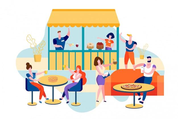 テーブルに座って公共の場で外食する人々