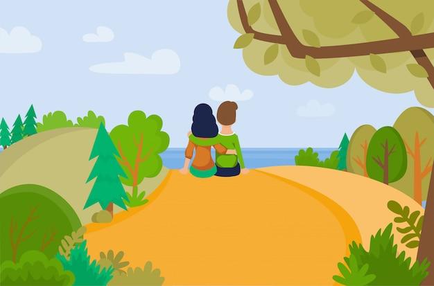 丘の上に座って素敵なカップル