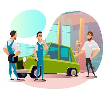 Ремонтный персонал и проколотое колесо на автомобиле