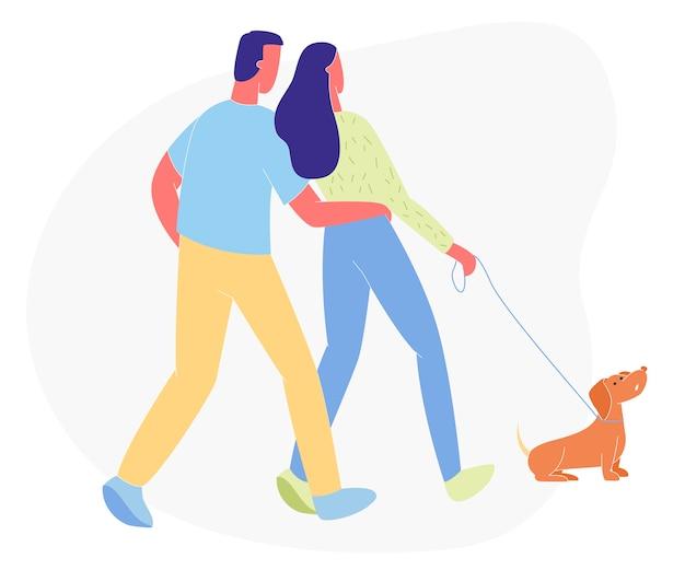 白い背景で隔離の犬とカップルの散歩。