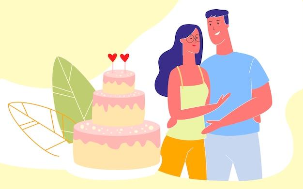 周年記念お祝い若い幸せなカップルを抱いて