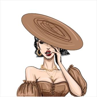 Мода чувственная женщина в плоской коричневой шляпе