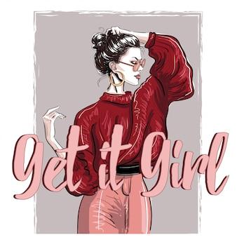 Модная девушка в красном пуловере с надписью
