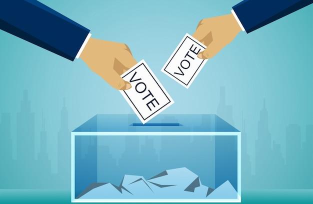 投票箱に選挙投票投票を持っている手。投票の政治概念