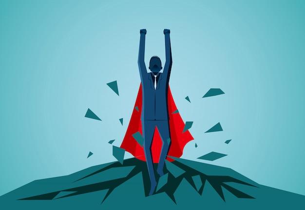 岩の上から飛び出しているスーパーヒーローのビジネスマンは空に飛び立っています