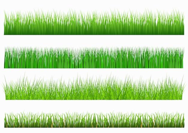 白い背景の上の緑の草を設定します
