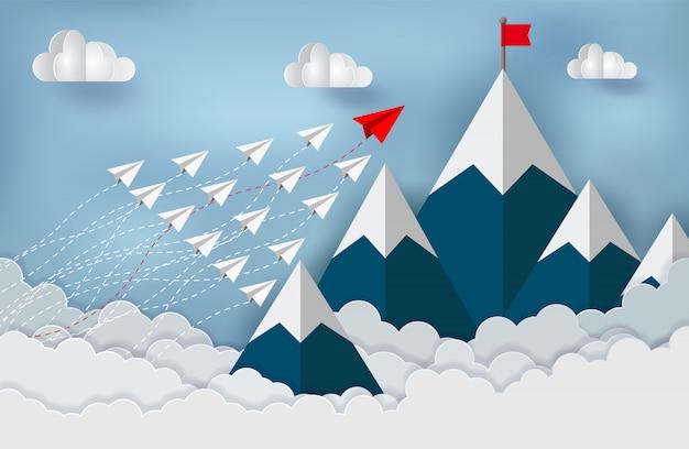 紙飛行機が競争している赤旗先に行く