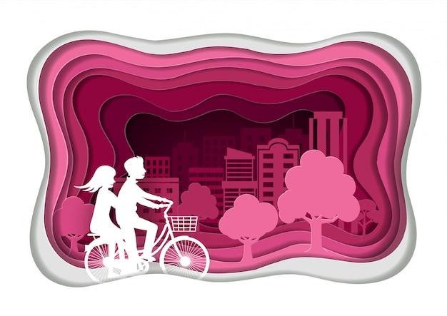 紙アートスタイル。男性と女性の恋人はサイクリングしています。ピンクの公立公園で