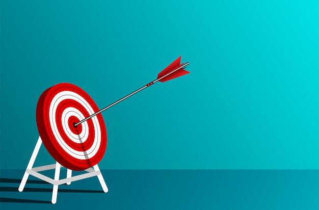 ターゲットサークルに赤い矢印ダーツ。ビジネス成功の目標背景の青に。リーダーシップ。