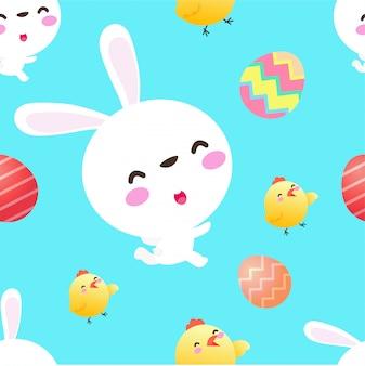 幸せなイースターエッグとひよこのシームレスなパターンを持つかわいいウサギ。