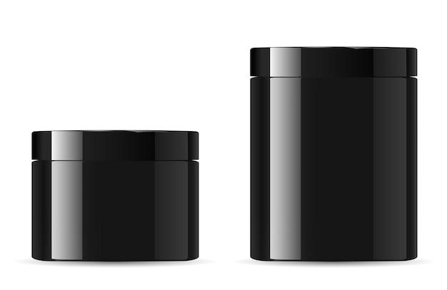 黒の化粧品のクリーム色の瓶。光沢のある包装