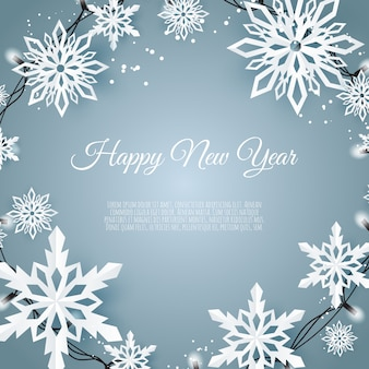 紙雪の結晶、青色の背景に落ちる雪のクリスマスカード
