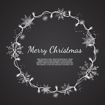 クリスマスホリデーグリーティングカードの輝くクリスマスライトリース、