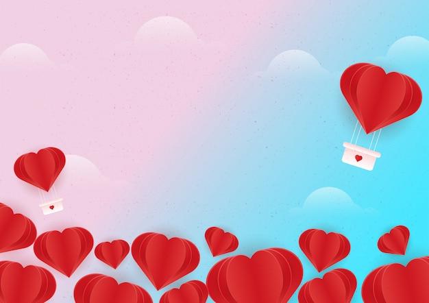 空を飛んでいる赤いハートの気球のペーパーアート