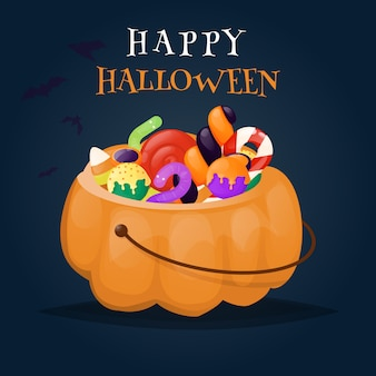 Хэллоуин тыква корзина полна конфет и сладостей.