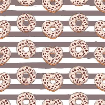 シームレスパターン。トッピング、チョコレート、ナッツで飾られた艶をかけられたドーナツ。