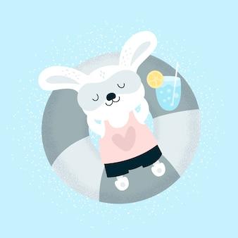 ビーチでリラックスした面白い小さなウサギの赤ちゃん