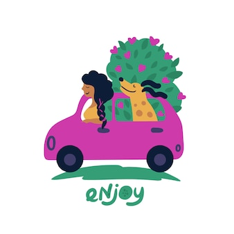 花の花束が付いている車の中で少女