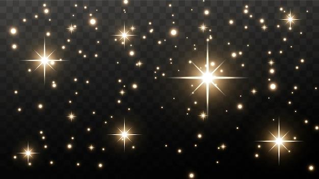 Золотые искры и золотые звезды сверкают реальным световым эффектом. взрыв золотого конфетти.