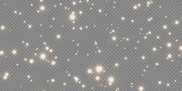 Сверкающая волшебная пыль. на текстурном белом фоне. праздник абстрактный фон из золотых блестящих частиц пыли. волшебный эффект. золотые звезды.