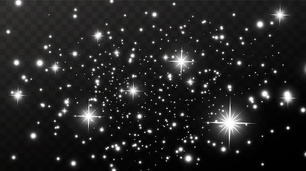 Сверкающая волшебная пыль. на текстурном белом и черном фоне. празднование абстрактный фон света и серебра сверкающих частиц пыли и звезд. волшебный эффект.