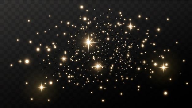Сверкающая волшебная пыль. на текстурном черном фоне. праздник абстрактный фон из золотых блестящих частиц пыли. волшебный эффект. золотые звезды.