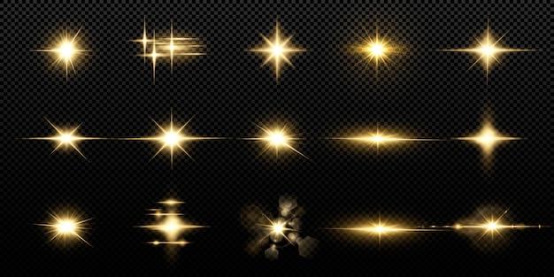 黒の背景に分離された輝く黄金の星。エフェクト、レンズフレア、輝き、爆発、黄金色の光、セット。輝く星、美しい黄金色の光線。