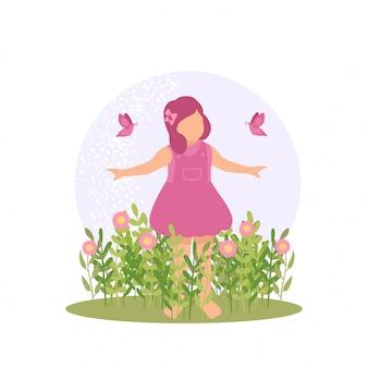 春のかわいい子供女の子が花と蝶の自然で遊ぶ