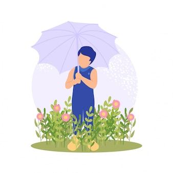 屋外の花をしている春のかわいい男の子