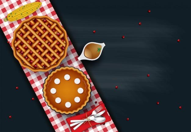 おいしいローストチキンや七面鳥のカトラリーとソース、プレート上の野菜のグリル焼き野菜、トップビュー。感謝祭の日の食べ物