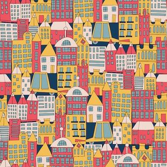 色のシームレスパターンの形で街の建物。
