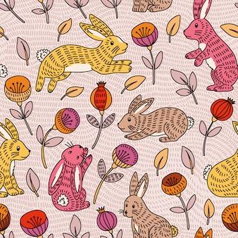 かわいいカラフルなウサギと花とのシームレスなパターン
