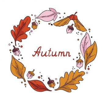 秋のラウンドフレーム。紅葉とドングリの花輪