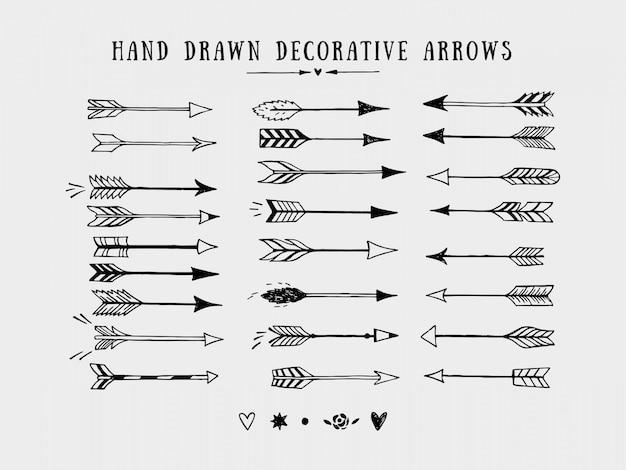 Векторные винтажные декоративные стрелки набор. ручной обращается векторные элементы дизайна