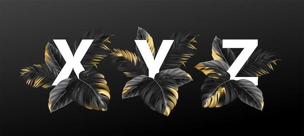植物のエキゾチックな熱帯の葉でのアルファベットの文字。