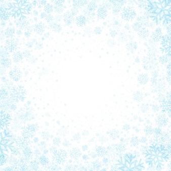 雪片の背景と青色の背景